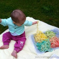 Baby playing with spaghetti