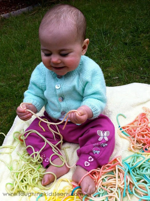 outdoor sensory fun for babies using spaghetti
