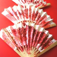 Toddler activity decorating fans for Chinese New Year.