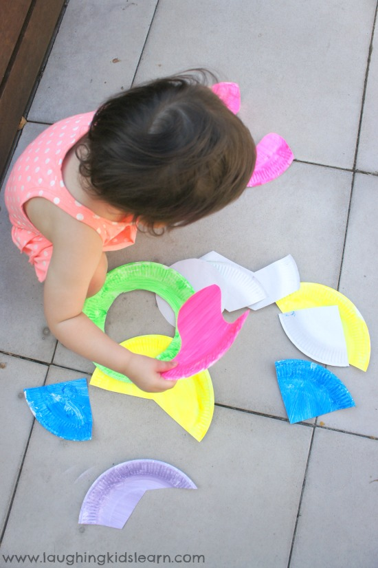 Sorting paper puzzle pieces for play