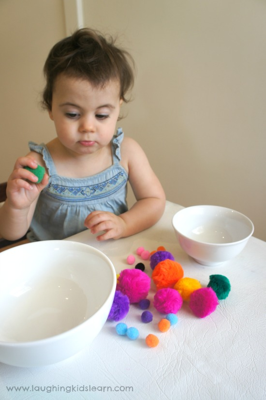 Toddler activity sorting big and small pom poms