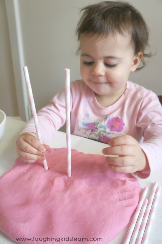 Poking Straws into play dough for fine motor activity #threadingactivity #toddleractivity #toddleractivities #finemotor #finemotorskills #funforkids #playdough #playdoughactivity #threading #straws #toddlers #preschoolers #earlyyears #pastathreading #indooractivities #busykids #lovetoplay