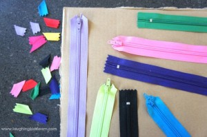 Arranging zippers on sensory board for children