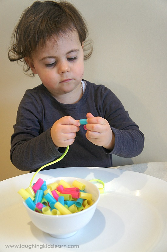 threading necklace with straw beads. Great for fine motor.