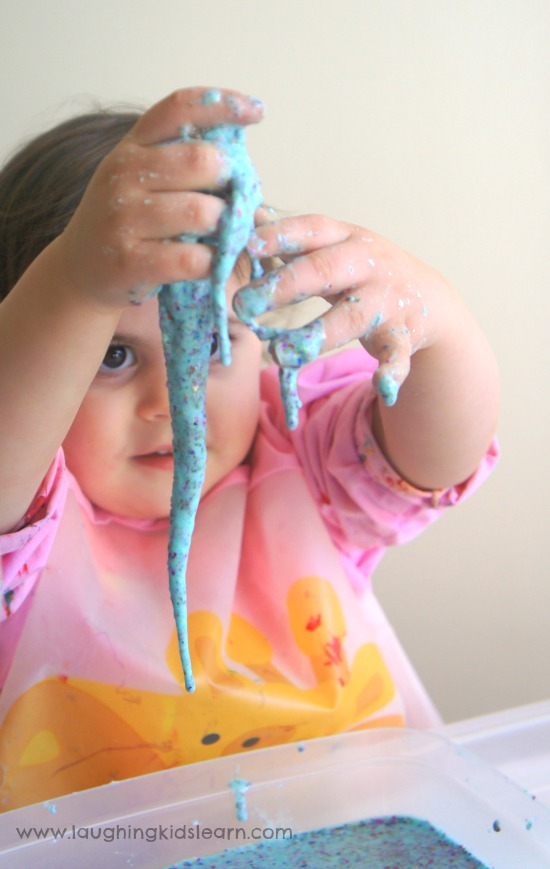 sensory experience of oobleck goo through messy play