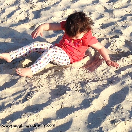 toddler enjoying sand