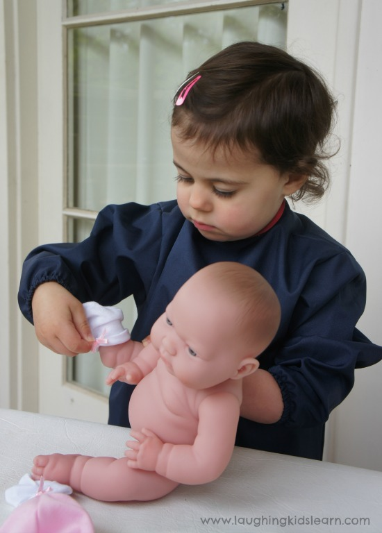 dressing baby doll pretend play