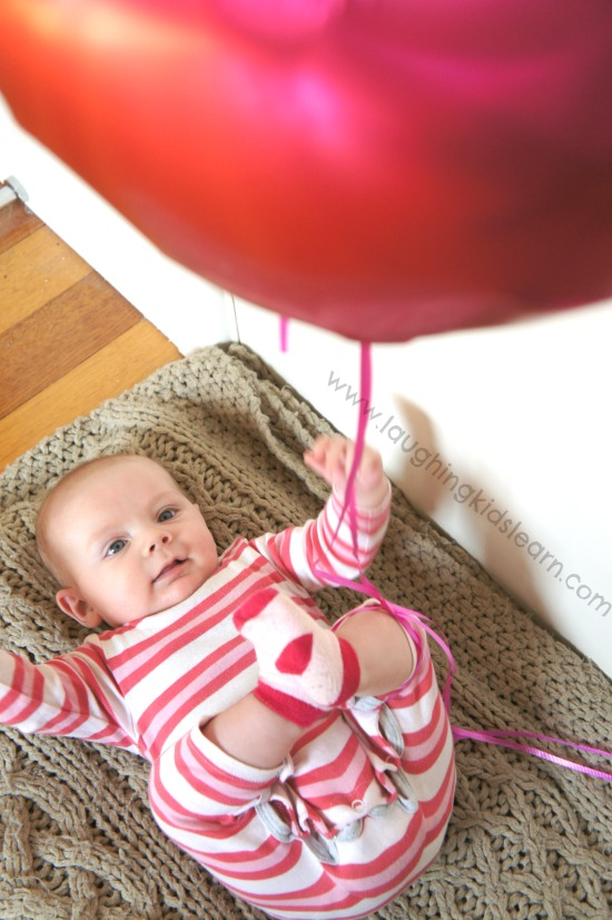 Kicking balloon play for baby