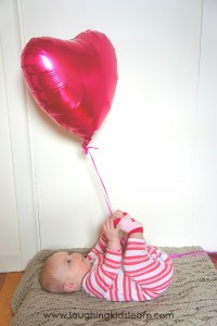 Baby play with balloons