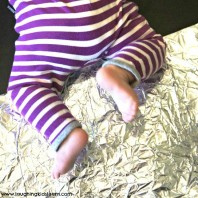 Baby play sensory activity using tin foil