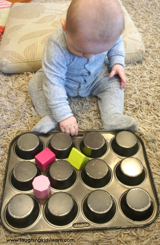 Baby flipping tray with blocks on it.
