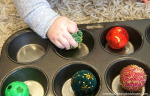 Sensory baby play activity using a muffin tin