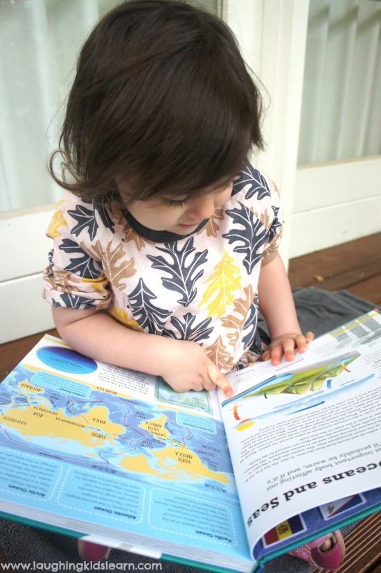 children learning about different countries using lonely planet atlas