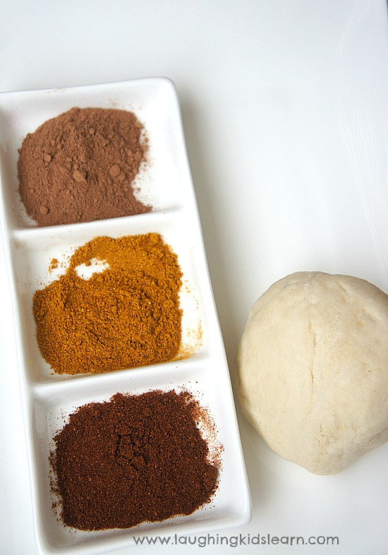 Mixing fresh playdough and using spices and seeds in playdough