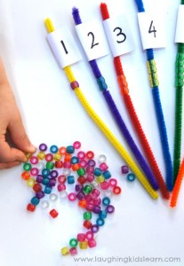 Playing and learning with pipe cleaners and beads. Great for fine motor skills too.