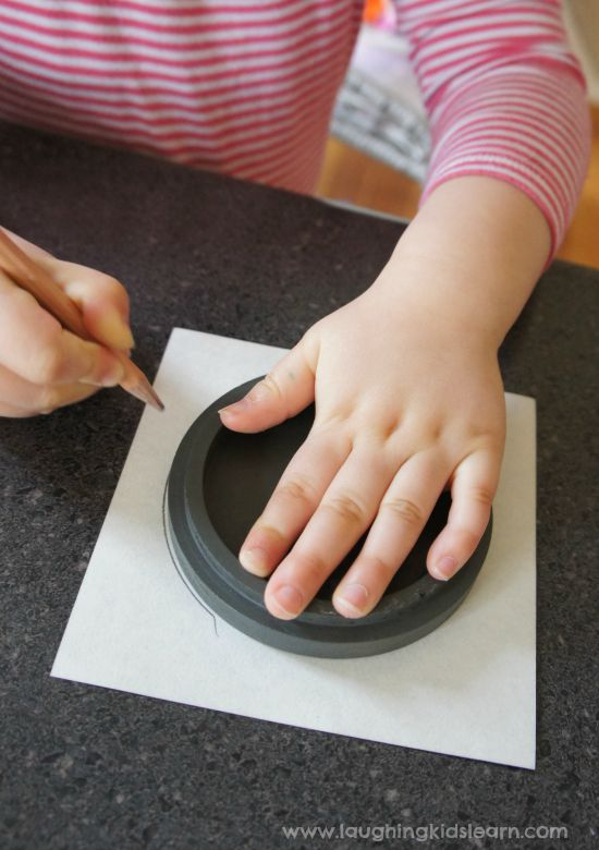 Preschooler tracing around an object