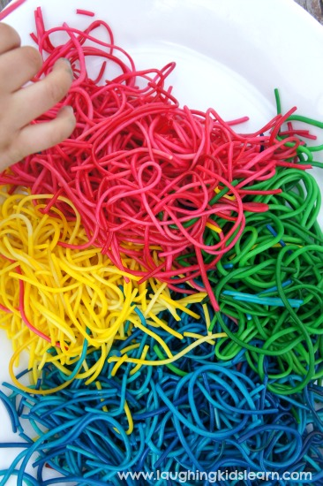 Colored spaghetti for sensory play with children