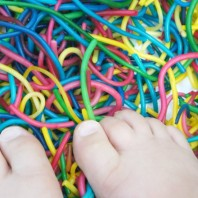 Using feet in spaghetti play for sensory learning