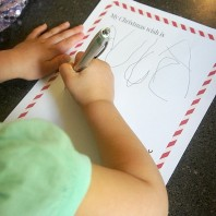Writing a letter to Santa on free Christmas printable