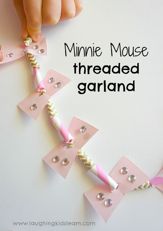 Minnie Mouse threaded garland craft for preschoolers. Great activity for Christmas