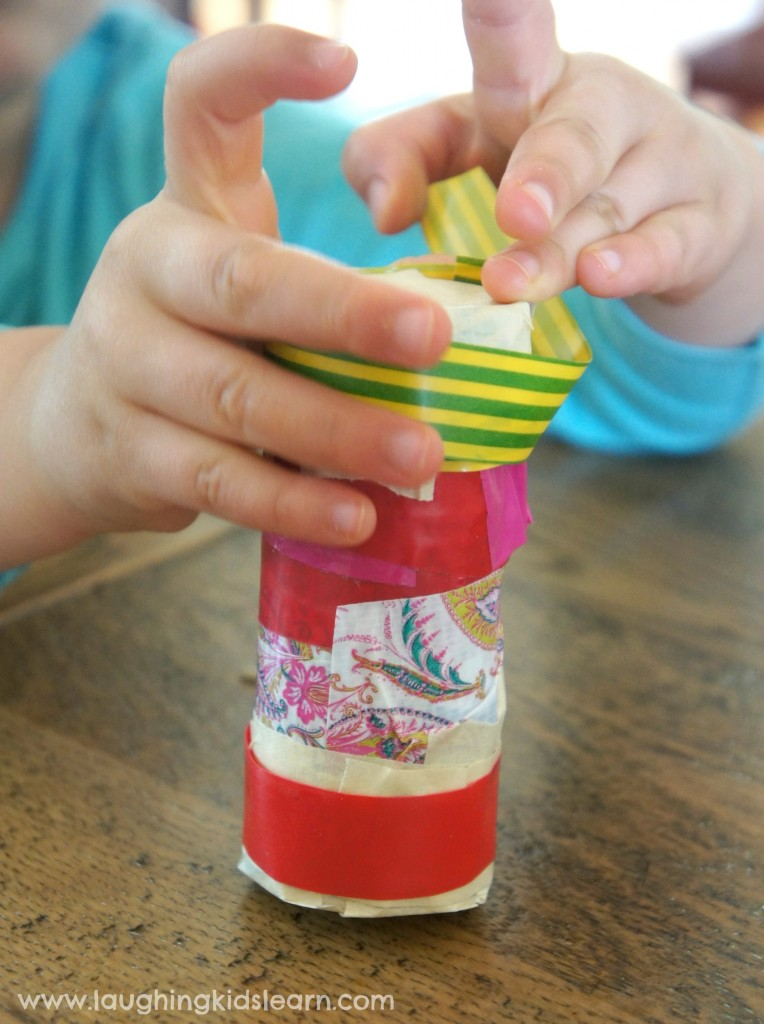 making musical shaker with toilet roll