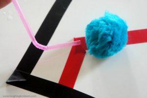 Pom pom challenge using a straw and tape