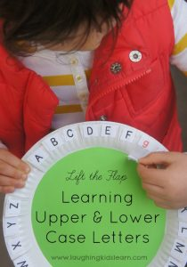 lift the flat to learn upper and lower case letters using a paper plate