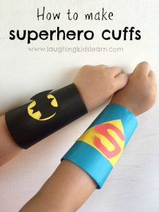 how to make superhero cuffs using toilet rolls and paper.