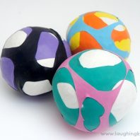 Juggling balls using balloons and rice