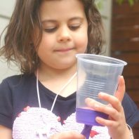 Pom Pom Popper or Shooter fun using plastic cup and balloon