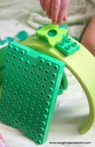building construction with green objects