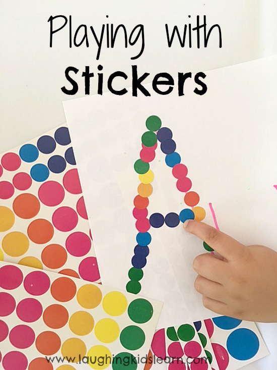 Kids playing and learning with stickers for fun and fine motor development