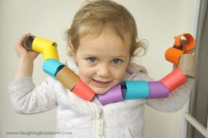 Threading activity for toddlers using cardboard beads