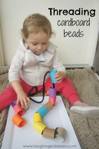 Threading cardboard beads. Activity for toddlers and preschoolers