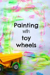Painting with toy car and truck wheels. Fun painting activity for kids.
