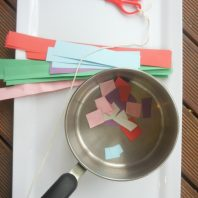 DIY scissor cutting station to help children learn to cut with scissors