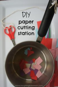 DIY paper cutting station for children learning to cut with scissors