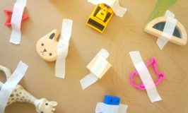 sticking toys down with sticky tape