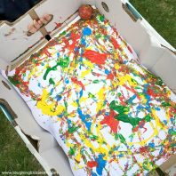 painting together using ball box and paint