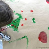 Painting gift wrapping paper for christmas gifts