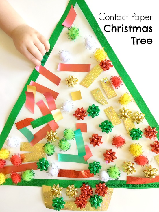 Toddler Christmas activity using sticky contact paper