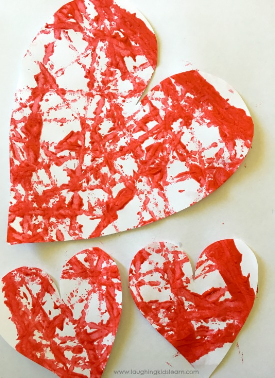 painted hearts for valentines day cards made by toddlers and preschooler #valentinesdayactivity #activityforkids #happyvalentinesday #kidspaint #paintingwithkids #lovelovelove #lovehearts #paperactivities #kidscraft
