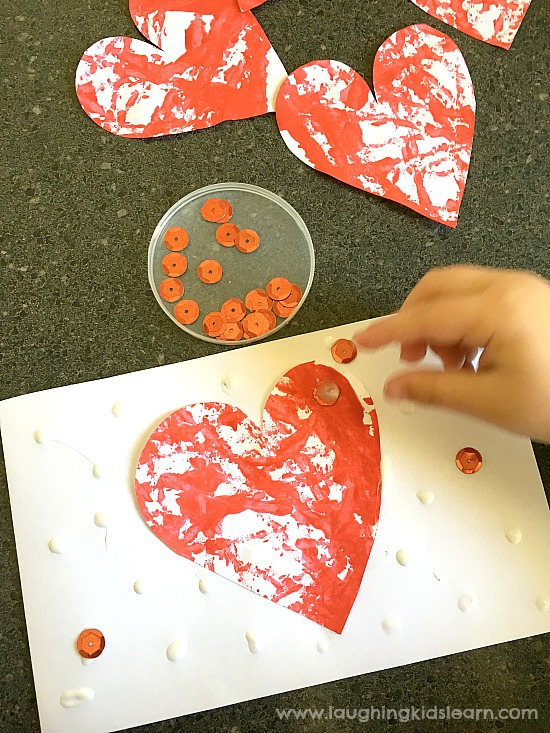 toddler and preschooler decorating valentines day cards #valentinesdaycards #happyvalentinesday #kidscraft #giftidea #kidsmaking #paintingwithkids #lovetomake