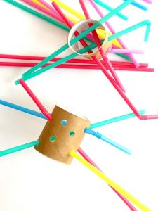 cardboard and straws for fine motor development and fun for kids