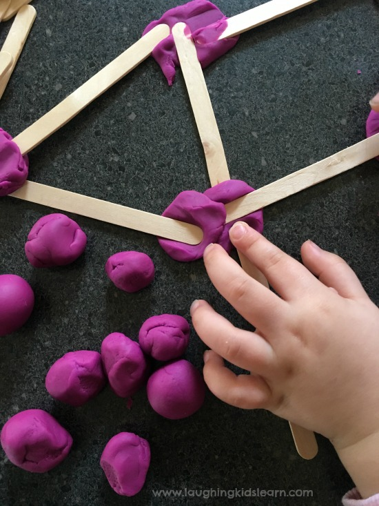 play dough and craft sticks