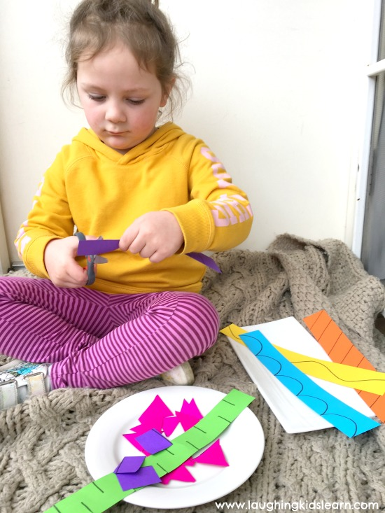 cutting paper pieces for fine motor activity