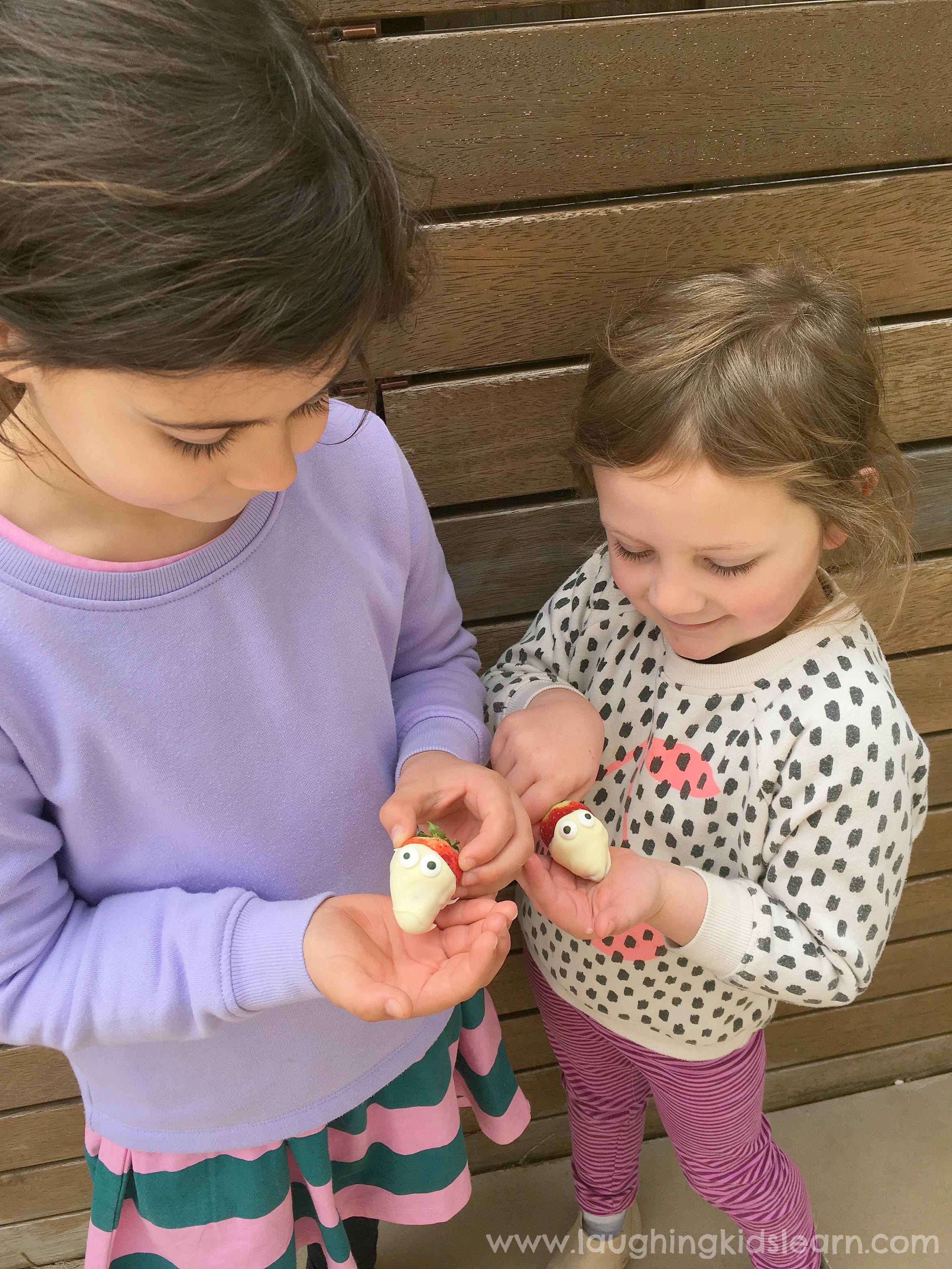 children with chocolate strawberries