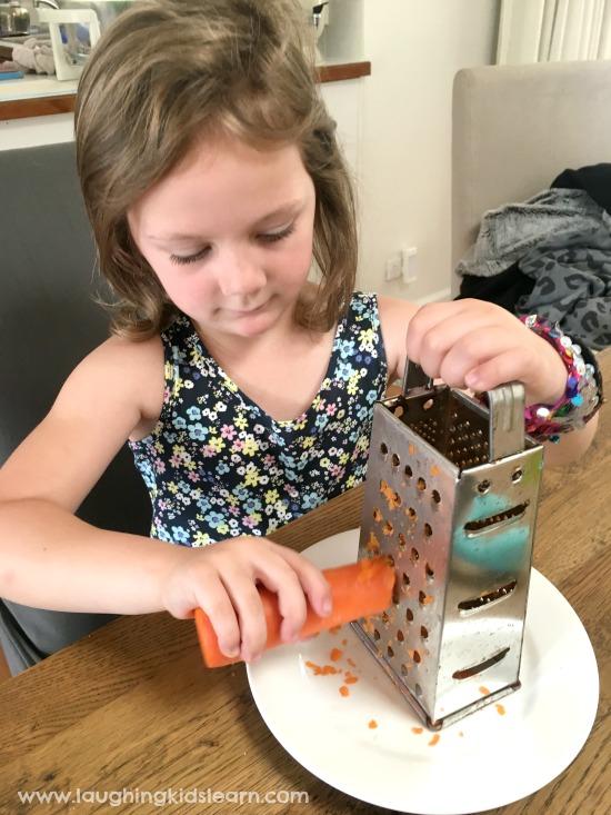 Kids grating carrot