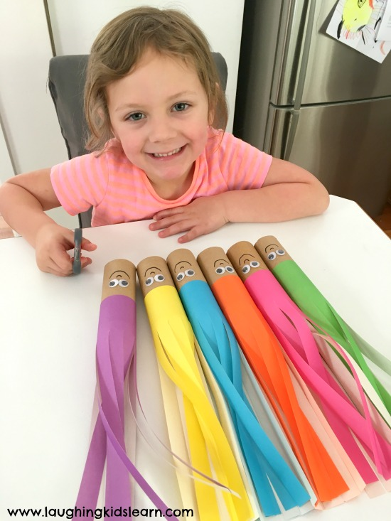 Scissor cutting hair activity that's fun for children of all ages. Great way to improve fine motor skills.