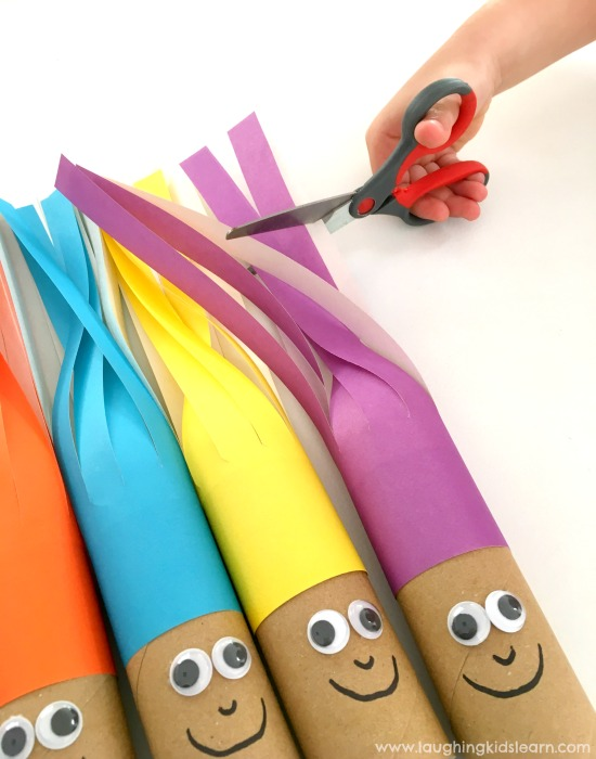 Scissor cutting hair activity. Super fun for children of all ages. Great way to develop those fine motor skills.